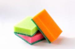 Tres esponjas coloreadas Imagenes de archivo