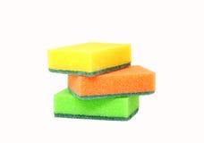 Tres esponjas para los platos que se lavan Imágenes de archivo libres de regalías