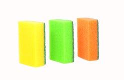 Tres esponjas para los platos que se lavan fotografía de archivo