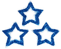 Tres estrellas abstractas de brillo azul chispean en el fondo blanco para su diseño Imagen de archivo libre de regalías