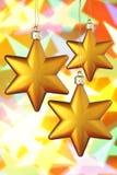 Tres estrellas de la Navidad del oro Foto de archivo libre de regalías