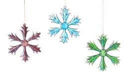 Tres estrellas o copos de nieve de cristal brillantes Imágenes de archivo libres de regalías
