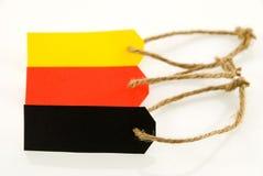 Tres etiquetas de la etiqueta de plástico en diversos colores Fotografía de archivo libre de regalías