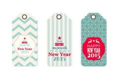 Tres etiquetas de la Navidad en estilo elegante lamentable Imágenes de archivo libres de regalías