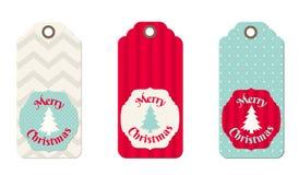 Tres etiquetas de la Navidad en estilo elegante lamentable Foto de archivo