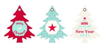 Tres etiquetas de la Navidad en la forma del árbol libre illustration