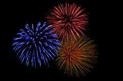 Tres explosiones coloridas del fuego artificial imagen de archivo