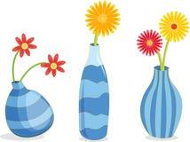 Tres floreros azules ilustración del vector