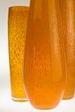 Tres floreros de cristal anaranjados Imagen de archivo libre de regalías