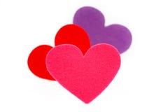 Tres formas coloreadas del corazón Fotografía de archivo
