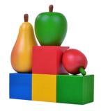 Tres frutas de madera en los cubos coloreados Fotos de archivo