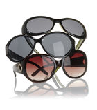 tres gafas de sol con el fondo blanco Foto de archivo libre de regalías