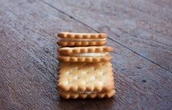 Tres galletas en la madera Imagen de archivo libre de regalías