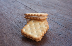 Tres galletas en la madera Fotos de archivo libres de regalías