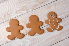 Tres galletas una del pan de jengibre adornadas Fotografía de archivo libre de regalías