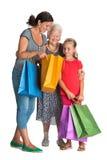 Tres generaciones de mujeres con los bolsos de compras Fotografía de archivo libre de regalías
