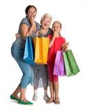 Tres generaciones de mujeres con los bolsos de compras Imágenes de archivo libres de regalías