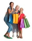 Tres generaciones de mujeres con los panieres Imagen de archivo libre de regalías