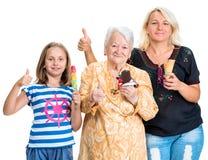 Tres generaciones de mujeres felices con helado Imágenes de archivo libres de regalías