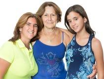 Tres generaciones de mujeres hispánicas aisladas en blanco Imagenes de archivo