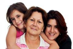 Tres generaciones de mujeres latinas aisladas en blanco Imagenes de archivo