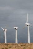 Tres generadores de la energía eólica. Foto de archivo