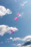 Tres globos rosados Imagenes de archivo