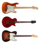Tres guitarras eléctricas en el fondo blanco Imagen de archivo libre de regalías