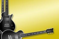 Tres guitarras negras en fondo amarillo Foto de archivo libre de regalías