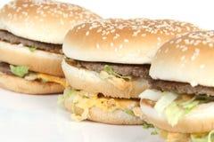 Tres hamburguesas Foto de archivo libre de regalías