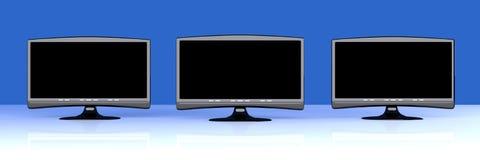 Tres HDTVs Imagen de archivo libre de regalías