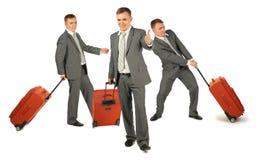 Tres hombres de negocios con equipaje en el blanco, collage Imagenes de archivo