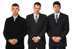 Tres hombres de negocios jovenes permanentes Fotos de archivo libres de regalías