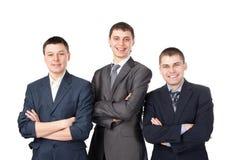 Tres hombres de negocios sonrientes jovenes Imagenes de archivo