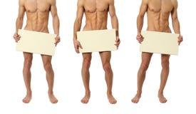 Tres hombres desnudos que cubren con una muestra en blanco Foto de archivo