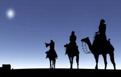 Tres hombres sabios que siguen una estrella Imagenes de archivo