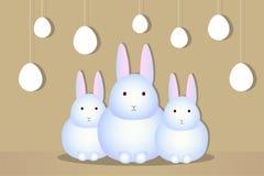 Tres huevos blancos de las siluetas del conejo Fotografía de archivo libre de regalías