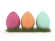 Tres huevos pintados. Fotografía de archivo