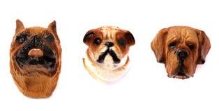 Tres imanes del refrigerador de la cabeza de perro fotografía de archivo