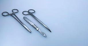 Tres instrumentos quirúrgicos Imágenes de archivo libres de regalías