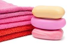 Tres jabones y toallas Fotos de archivo libres de regalías