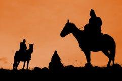 Tres jinetes, Kirguizistán Foto de archivo libre de regalías