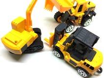 Tres juguetes del vehículo de la construcción Fotos de archivo