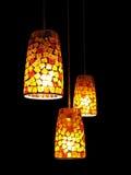 Tres lámparas en la obscuridad Imágenes de archivo libres de regalías