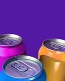 Tres latas coloridas de la bebida Imágenes de archivo libres de regalías