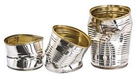 Tres latas de estaño dañadas imágenes de archivo libres de regalías