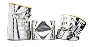 Tres latas de estaño dañadas Foto de archivo libre de regalías