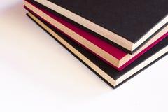 Tres libros apilados fotografía de archivo