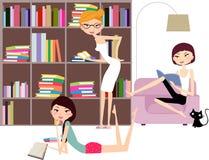 Tres libros de lectura de las muchachas Fotos de archivo libres de regalías