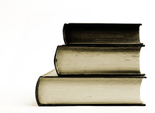 Tres libros muy viejos en sepia aislados en blanco foto de archivo libre de regalías